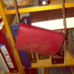 Red Michael Kors crossbody bag